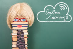 Online learning. Funny education concept with unusual women teacher Stock Photography