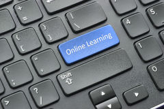 Online learning key on keyboard. Blue online learning key on black keyboard Stock Image