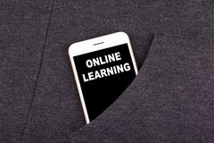 Online Learning. Smartphone in pocket. Technology business and communication, education background royalty free stock image