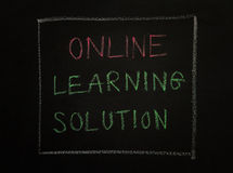 ONLINE LEARNING SOLUTION, message on black background. Stock Photography