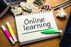 Online Learning. Text on the desk Stock Images