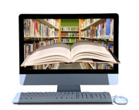 Online library e-book research and education. A book coming out of a computer with a library on the screen of the computer representing online library, school royalty free stock photography