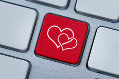 Online love, two hearts symbol at the computer key royalty free stock photos