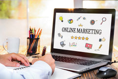 Online Marketing Concept On Laptop Monitor. Online Marketing Concept With Various Hand Drawn Doodle Icons On Laptop Monitor stock photo