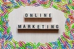 Online Marketing words concept on cubes stock photos