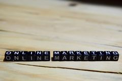 Online marketing written on wooden blocks. stock photos