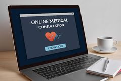 Online medical consultation concept on laptop computer screen. Online medical consultation concept on modern laptop computer screen on wooden table. All screen Stock Photography