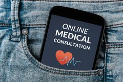 Online medical consultation concept on smartphone screen in jean. S pocket. All screen content is designed by me. Flat lay Stock Image