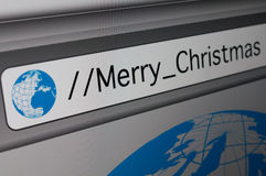 Online Merry Christmas. Merry Christmas Sign - Closeup of Computer Screen With Favicon and URL Address Bar in Fictitious Web Browser - Shallow Depth of Field Royalty Free Stock Photos