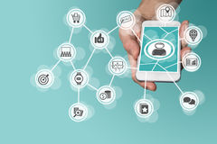 Online mobile marketing by leveraging big data, analytics and social media. Concept with hand holding modern smart phone