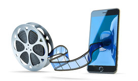 Online mobile video concept. Movie and multimedia content storage, blue filmstrip from film reel moving to modern black phone on white background Royalty Free Stock Images