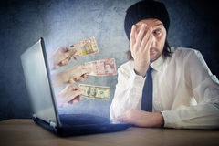 Online money funds, surprised businessman receiving cash over in. Ternet. Earning money on network Stock Photo