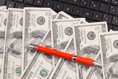 Online Money Spending. Pen on Money with Computer Stock Photos