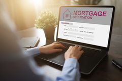 Free Online Mortgage Application On Screen. Property Loan. Business And Financial Concept. Stock Photography - 128105452