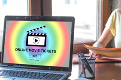 Online movie tickets buying concept on a laptop screen. Laptop screen displaying an online movie tickets buying concept Royalty Free Stock Images