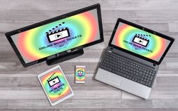 Online movie tickets buying concept on different devices. Online movie tickets buying concept shown on different information technology devices Royalty Free Stock Photos