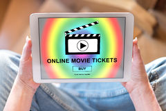 Online movie tickets buying concept on a tablet. Tablet screen displaying an online movie tickets buying concept Stock Photo