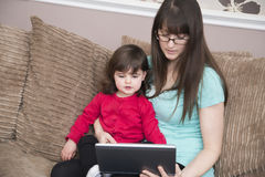 Online with Mummy royalty free stock photos