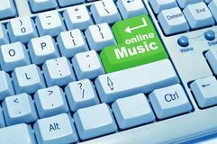 Online music of computer keyboard. The green button experience of computer keyboard Royalty Free Stock Photo