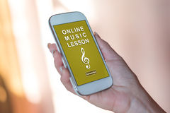 Online music lesson concept on a smartphone Royalty Free Stock Images