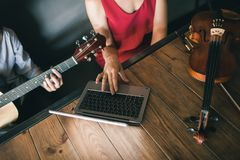 Online music school play instrumental lessons. Online music school. young people learn how to play instruments through the internet. limitless possibilities for Royalty Free Stock Photo
