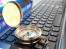 Online navigation. Compass on laptop keyboard. Royalty Free Stock Image