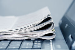 Online news. Newspapers on the laptop. shot in studio stock photo