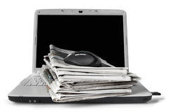 Online News. Newspapers stacked on laptop.  On-line news concept Royalty Free Stock Photo