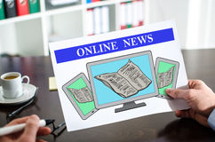 Online news concept on a paper Royalty Free Stock Photography