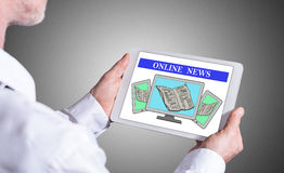 Online news concept on a tablet Stock Photo