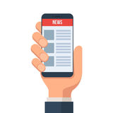 Online news on mobile phone Stock Images