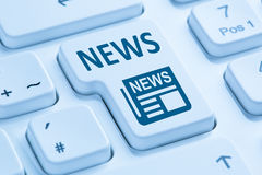 Online newspaper news blue computer keyboard Stock Images