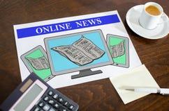 Online nieuwsconcept op een document royalty-vrije stock afbeeldingen