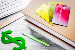 Online pay for fee-paying education on gray student desk backgro Royalty Free Stock Photos