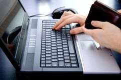 Online payment. Paying with wallet in hand Stock Photo