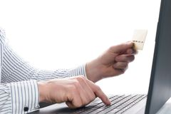 Online payment, Businessman`s  hands holding a credit card and using laptop Stock Photography
