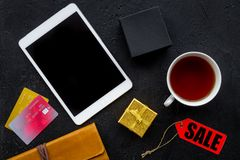 Online payment for christmas present with credit card and tablet on black table background top view mockup Stock Photos