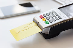 Online payment concept with credit card and terminal on white background Stock Photo