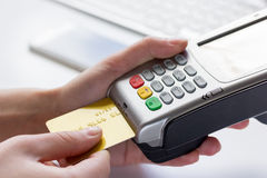Online payment concept with credit card and terminal on white background Royalty Free Stock Photo