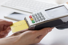 Online payment concept with credit card and terminal on white background Stock Photos