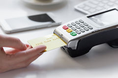 Online payment concept with credit card and terminal on white background Royalty Free Stock Image