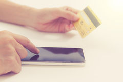 Online payment, hands holding a credit card and using smart phon Stock Image