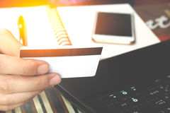 Online payment, man's hands holding a credit card over laptop an Royalty Free Stock Photography