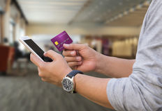 Online payment,The people hands holding a credit card and using Royalty Free Stock Image