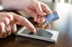 Online payment with a smartphone Stock Image