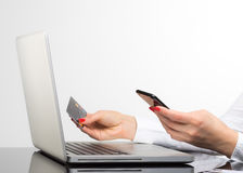 Online payment,Woman`s hands holding a credit card and using sma Stock Photography