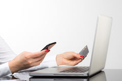 Online payment,Woman`s hands holding a credit card and using sma Stock Photo