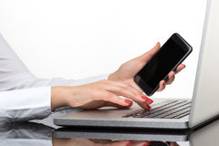 Online payment, Woman`s hands holding smart phone for online sho Stock Images