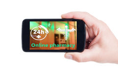 Online pharmacy concept on smartphone display or cellphone scree Stock Images