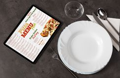 Online pizza menu with tableware concept. Non stop order online pizza menu with tableware conceptn stock photography